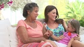 prole : Grandmother With Granddaughter And Daughter In Garden