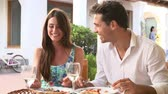 mosolyogva : Young Couple Eating Meal Outdoors Together Stock mozgókép
