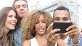 quatro : Group Of Friends Taking Selfie By Tower Bridge In London