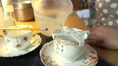 velas : Slow Motion Shot Of Woman Making Candles In Teacups At Home Vídeos
