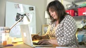 cera : Mature Woman Checking Orders For Home Business On Laptop