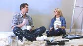 quadro : Expectant Couple Taking A Break Whilst Decorating Nursery Stock Footage