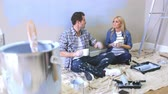 gravidez : Expectant Couple Taking A Break Whilst Decorating Nursery Stock Footage