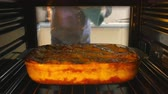 pasta dishes : Man Taking Cooked Dish Of Lasagne Out Of The Oven