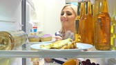 refrigerator : Woman Taking Plate Of Iced Cupcakes From The Fridge