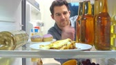 hungry : Man Taking Bottle Of Beer From The Fridge