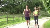 run : Slow Motion Shot Of Couple On Run In Countryside Together Stock Footage
