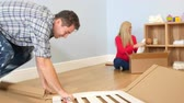 meble : Couple Preparing To Assemble Flat Pack Cot In Nursery Wideo