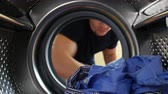 lavanderia : Man Putting Laundry Into Washing Machine