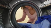 arruela : Woman Taking Laundry Out Of Washing Machine