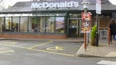 здание : Exterior View Of McDonalds Restaurant Entrance