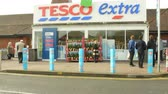 wide angle : Exterior View Of Tesco Supermarket Entrance Stock Footage