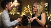 boates : Couple On Date Enjoying Evening Drinks In Bar