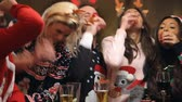 natal : Group Of Friends Enjoying Christmas Drinks In Bar