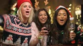 svetr : Group Of Female Friends Enjoying Christmas Drinks In Bar