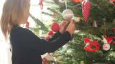 süsleme : Young Girl Hanging Decorations On Christmas Tree