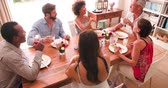 acima : Group Of Friends Enjoying Dinner Party At Home Together Vídeos