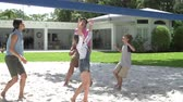 voleibol : Slow Motion Sequence Of Family Playing Volleyball In Garden