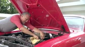 vermelho : Retired Senior Man Working On Restored Car In Slow Motion