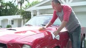 pastime : Retired Senior Man Cleaning Restored Classic Car