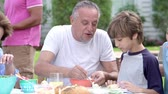 grandparents : Multi Generation Family Enjoying Meal In Garden Together Stock Footage