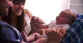 três pessoas : Parents In Bed Playing With Newborn Baby Daughter