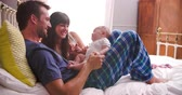mama : Parents In Bed Playing With Newborn Baby Daughter