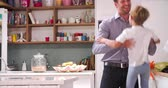 em linha : Son Playing In Kitchen Greeting Father Returning From Trip Stock Footage