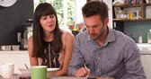 em linha : Couple Eating Breakfast Whilst Using Digital Tablet Stock Footage