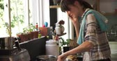 chamada : Busy Woman In Kitchen Cooking Meal And Talking On Phone