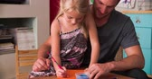 sypialnia : Father And Daughter Practicing Handwriting In Bedroom Wideo
