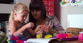 mama : Mother And Daughter Playing With Modeling Clay In Bedroom