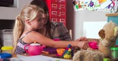 mama : Mother Having Tea Party With Daughter And Toys In Bedroom