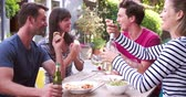 frame by frame : Group Of Friends Enjoying Outdoor Drinks In Garden