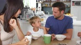 tendo : Family Eating Breakfast In Kitchen Together