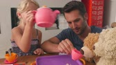 dzieci : Father Having Tea Party With Children And Toys In Bedroom