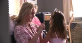 wróżka : Mother And Daughter Playing Dressing Up Game In Bedroom Wideo