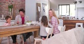dzieci : Family Eating Meal In Kitchen Together