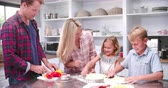 farinha : Family Making Pizza In Kitchen Together