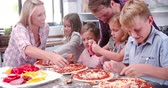 osoba : Family Making Pizza In Kitchen Together