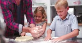 dough : Father And Children Making Pizza In Kitchen Together