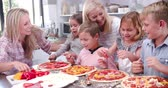 dzieci : Family Making Pizza In Kitchen Together