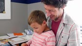 sypialnia : Father And Son Sitting In Bedroom Using Digital Tablet Wideo
