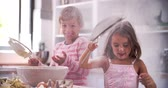 farinha : Slow Motion Shot Of Children Having Messy Fun In Kitchen