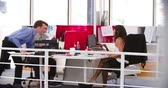quadros : People Working At Desks In Modern Open Plan Office Stock Footage