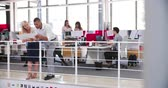 frame by frame : People Working At Desks In Modern Open Plan Office Stock Footage