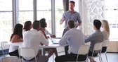 frame by frame : People Attending Business Meeting In Modern Open Plan Office