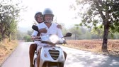 motor : Mature Couple Riding Motor Scooter Along Country Road