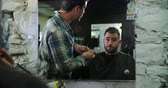 lustro : Male Barber Giving Client Haircut Reflected In Mirror
