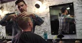 cutting in : Male Barber Giving Client Haircut In Shop